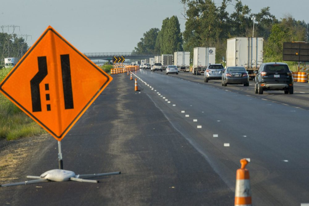 A highway merge sign nudges traffic to the right while paving work is underway in Oregon. (Courtesy Oregon Department of Transportation)