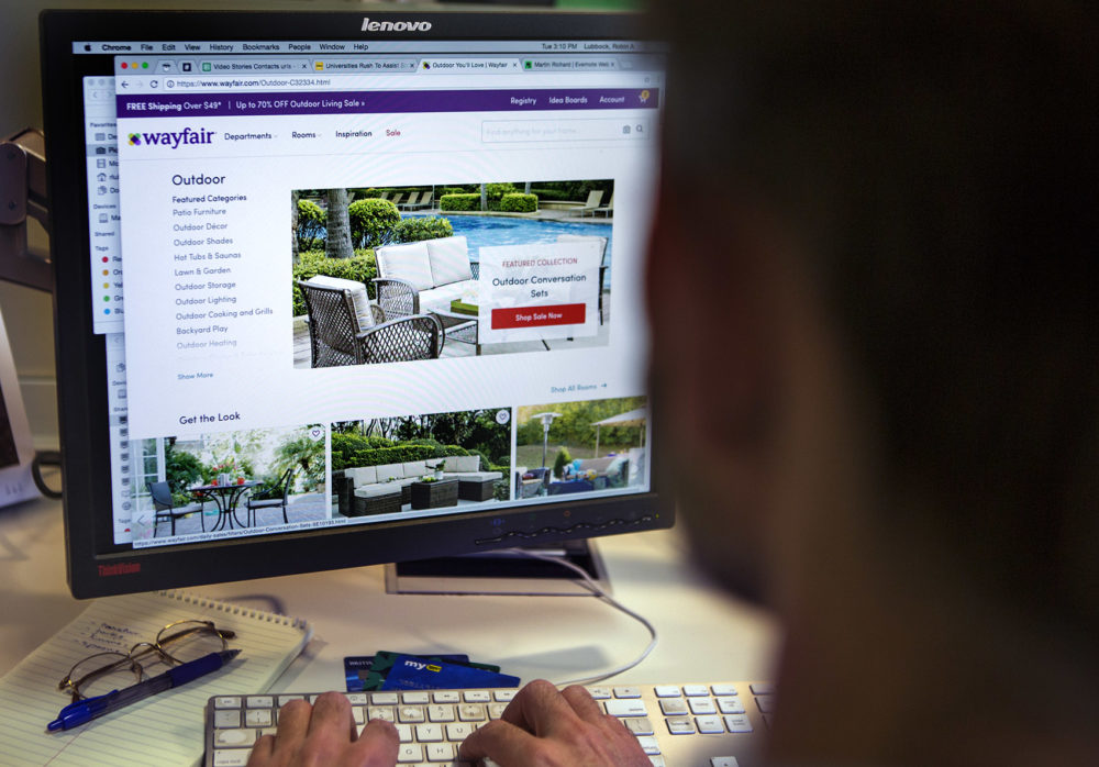 A person shopping at the Wayfair retail website. (Jesse Costa/WBUR)
