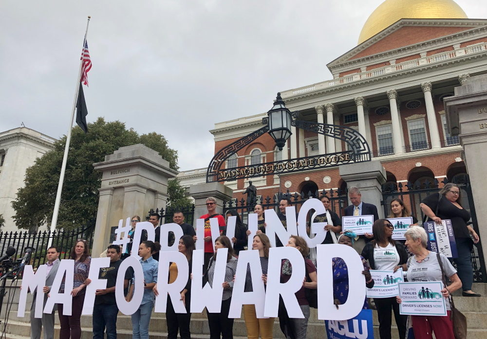 Proponents of driver's licenses for undocumented immigrants rallied in front of the State House on Wednesday morning ahead of a hearing on the proposal. [Photo: Colin A. Young/SHNS]