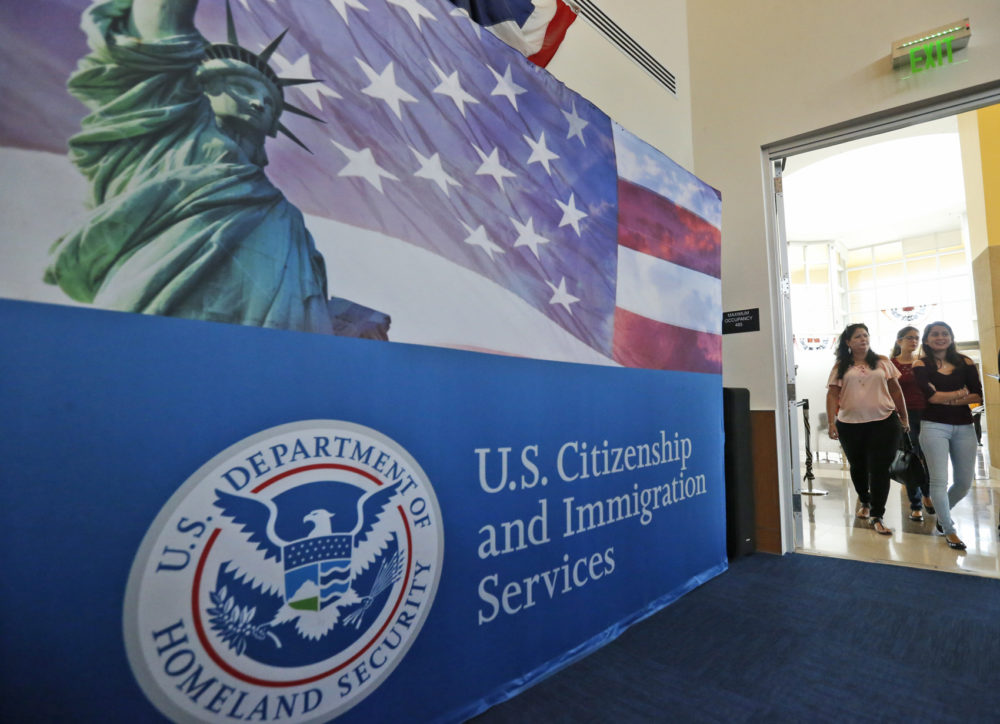 People arrive at the U.S. Citizenship and Immigration Services Miami Field Office in 2018 in Miami. (Wilfredo Lee/AP)