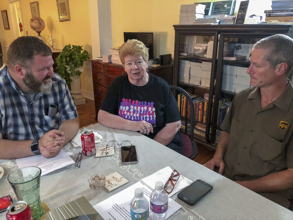 From left to right, Ted Figlock, Annemarie Matulis and Steven Palm at a support group meeting in Taunton. (Lynn Jolicoeur/WBUR)