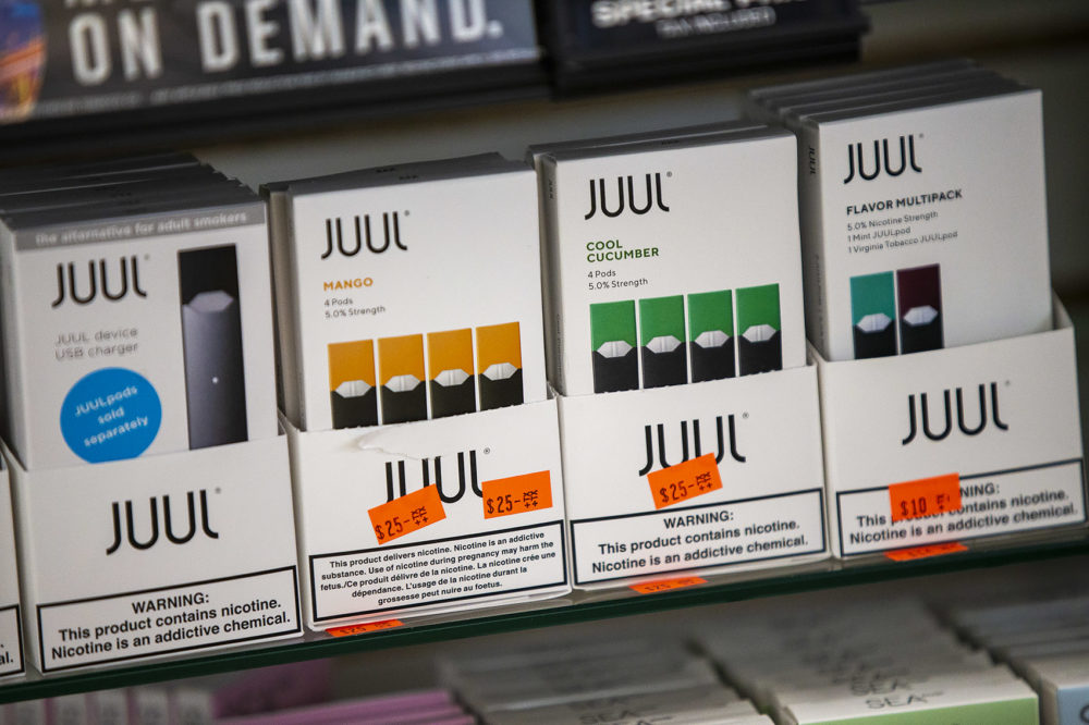 Various Juul products are on display at Fast Eddie's Smoke Shop in Allston. (Jesse Costa/WBUR)