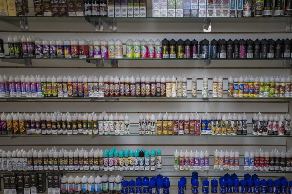 A huge selection of vaping juices at Liquid Smoke and Vape Shop in Allston that can no longer be legally sold. (Jesse Costa/WBUR)