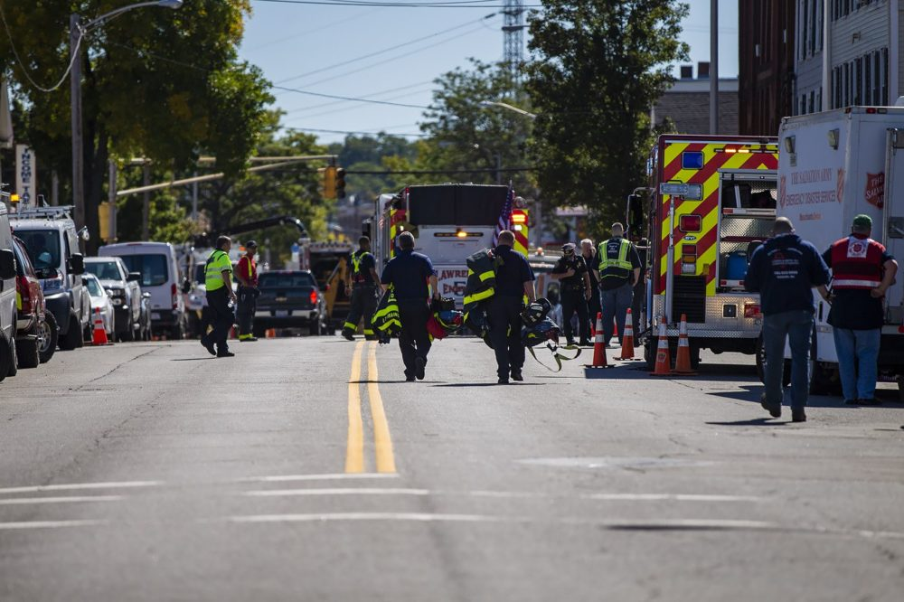 Police and fire personnel investigate a gas leak along South Broadway in Lawrence on Friday. (Jesse Costa/WBUR)