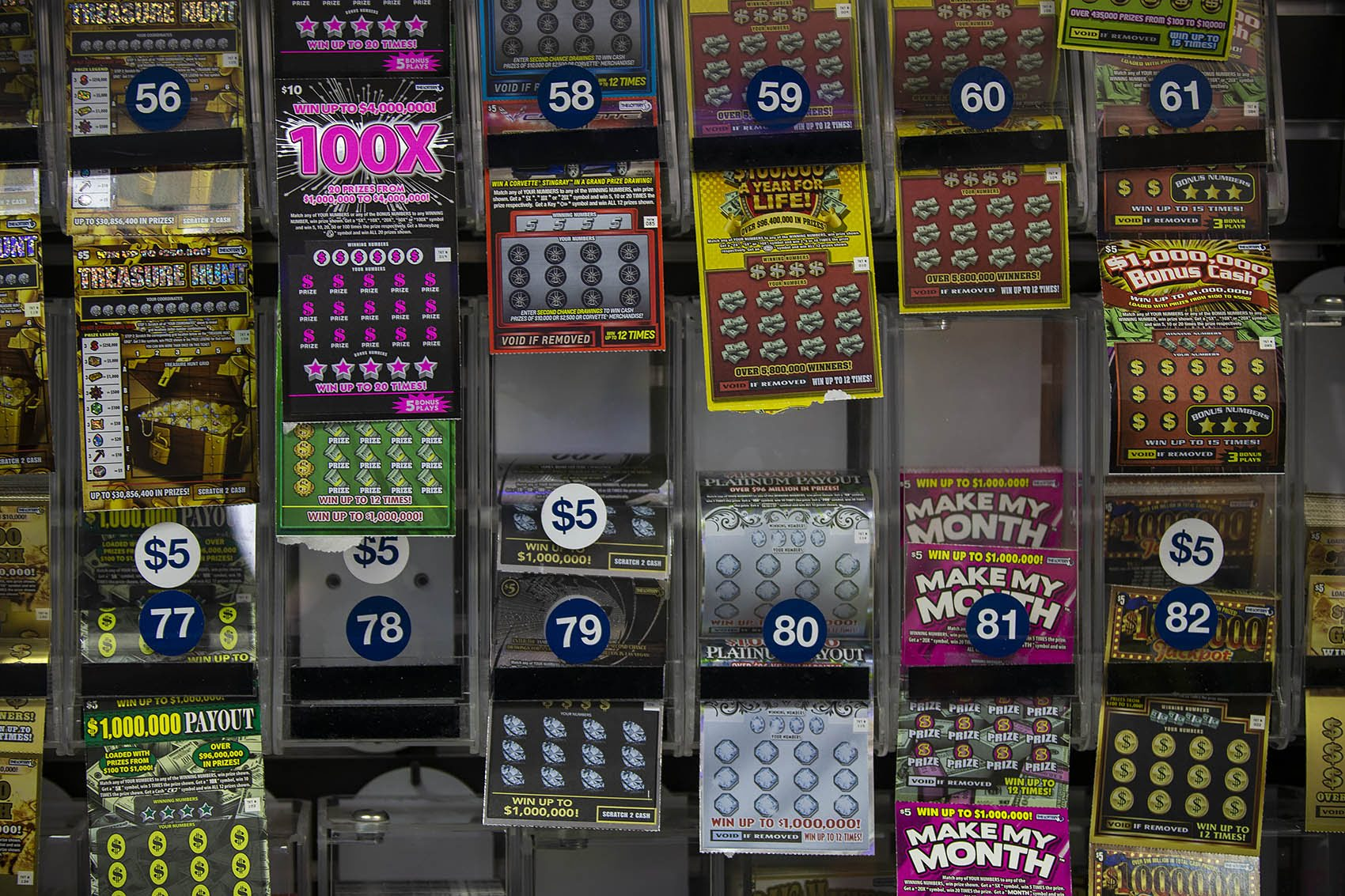 The lottery ticket display behind the counter at College Convenience on Huntington Avenue. (Jesse Costa/WBUR)