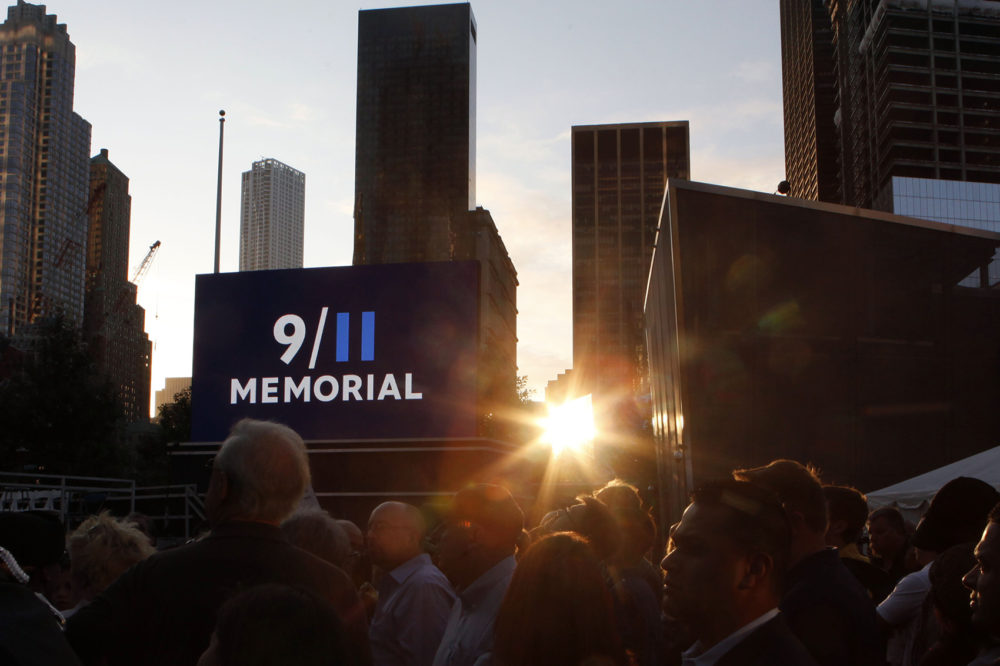 Friends and relatives of the victims of 9/11 gather for a ceremony marking the 10th anniversary of the attacks at the National September 11 Memorial at the World Trade Center site, Sunday, Sept. 11, 2011, in New York. (Jason DeCrow/AP)