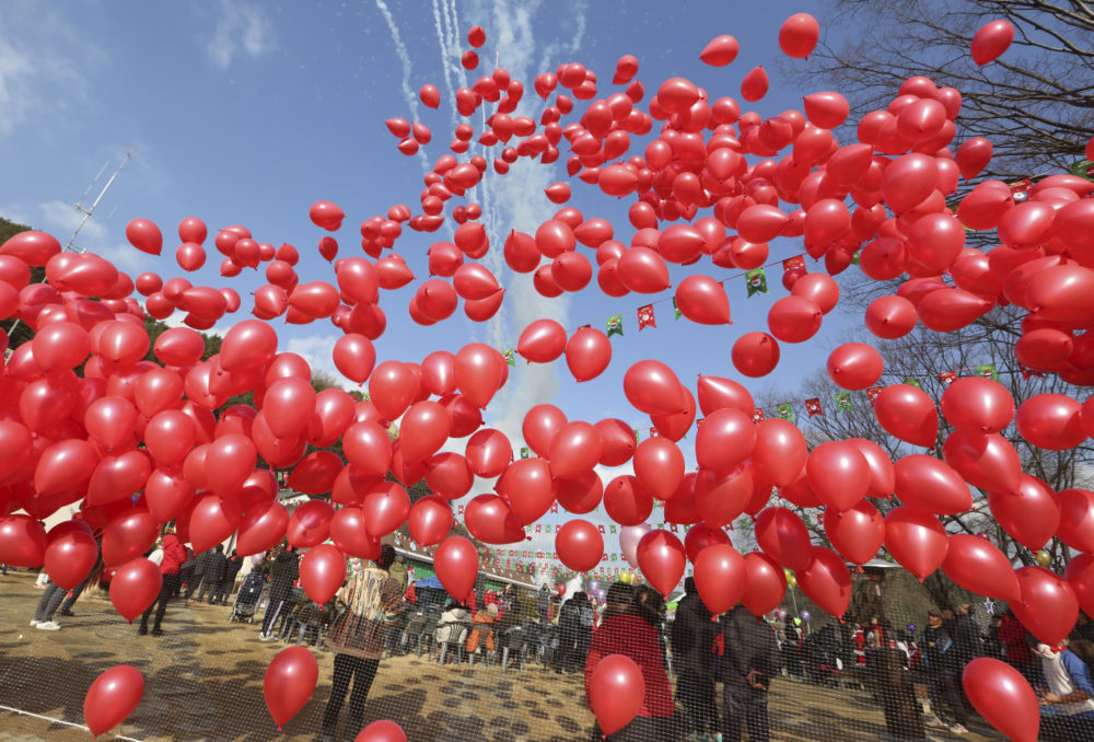 Some say releasing balloons for remembrance or celebration is an overlooked form of littering. (Ahn Young-joon/AP)
