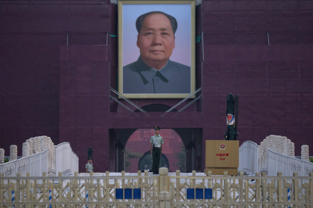 A Chinese paramilitary policeman stands guard in front of Mao Zedong's portrait on Tuesday, June 4, 2019. (Ng Han Guan/AP)