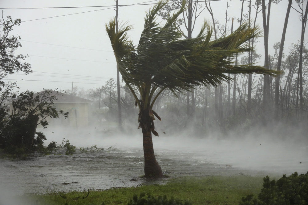 A road is flooded during the passing of Hurricane Dorian in Freeport, Grand Bahama, Bahamas, Monday, Sept. 2, 2019. Hurricane Dorian hovered over the Bahamas on Monday, pummeling the islands with a fearsome Category 4 assault that forced even rescue crews to take shelter until the onslaught passes. (Tim Aylen/AP)