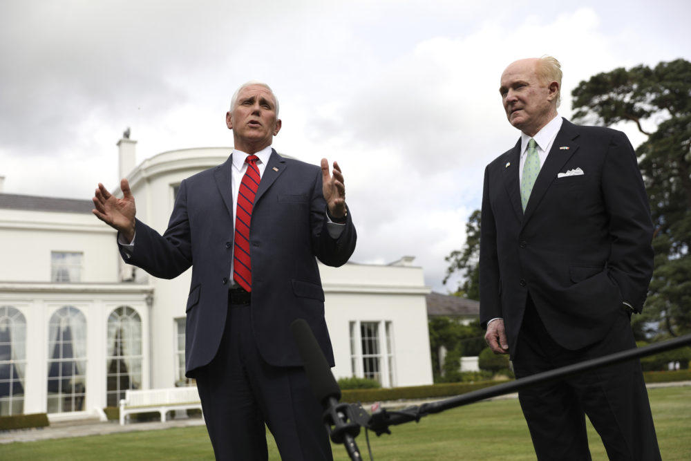 Vice President Mike Pence, left, and U.S. Ambassador to Ireland Edward Crawford speak to the media at the ambassador's residence in Dublin on Tuesday. Pence did not stay in Dublin. (Peter Morrison/AP)