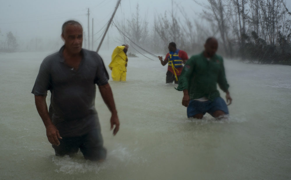 Volunteers wade through a road flooded by Hurricane Dorian as they work to rescue residents near the Causarina bridge in Freeport, Grand Bahama, Bahamas. (Ramon Espinosa/AP)