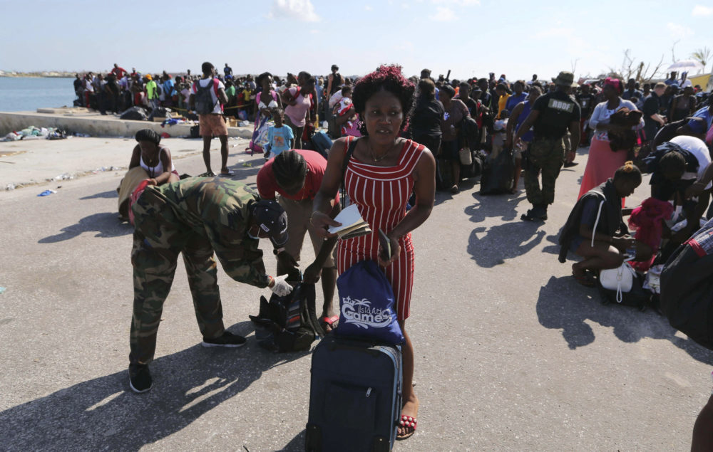 A Bahama's Army officer registers the people prior boarding a ferry to Nassau at the Port in Marsh Harbor, Abaco Island, Bahamas, Saturday, Sept. 7, 2019. The Bahamian health ministry said helicopters and boats are on the way to help people in affected areas, though officials warned of delays because of severe flooding and limited access. (Fernando Llano/AP)