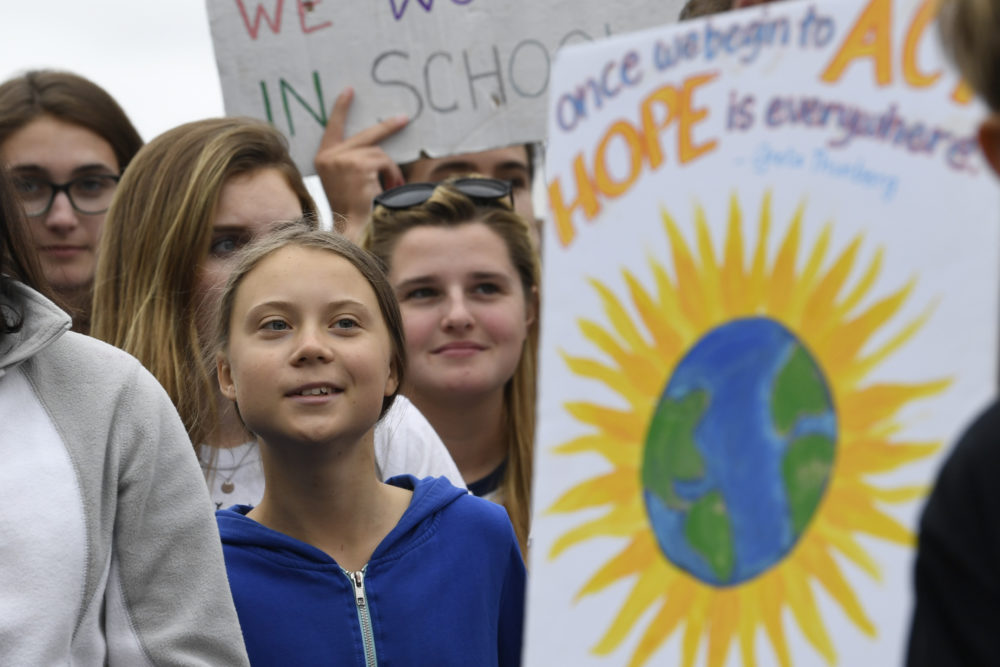 Swedish youth climate activist Greta Thunberg, center in blue, joins other young climate activists Friday for a climate strike outside the White House in Washington, Friday, Sept. 13, 2019. (Susan Walsh/AP)