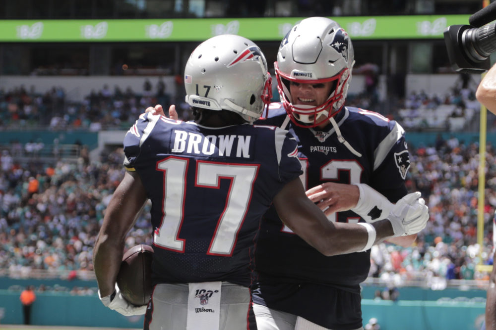 New England Patriots quarterback Tom Brady and wide receiver Antonio Brown celebrate after a touchdown in a game against the Miami Dolphins on Sunday.  (Lynne Sladky/AP)
