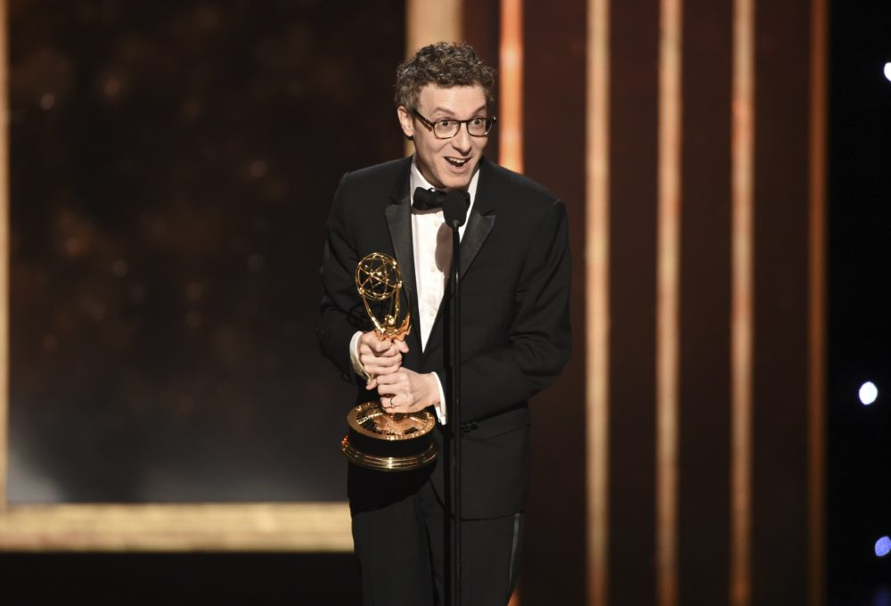 "Nicholas Britell accepts the award for outstanding original main title theme music for ""Succession"" on night two of the Television Academy's 2019 Creative Arts Emmy Awards on Sunday at the Microsoft Theater in Los Angeles. (Phil McCarten/Invision for the Television Academy/AP)"