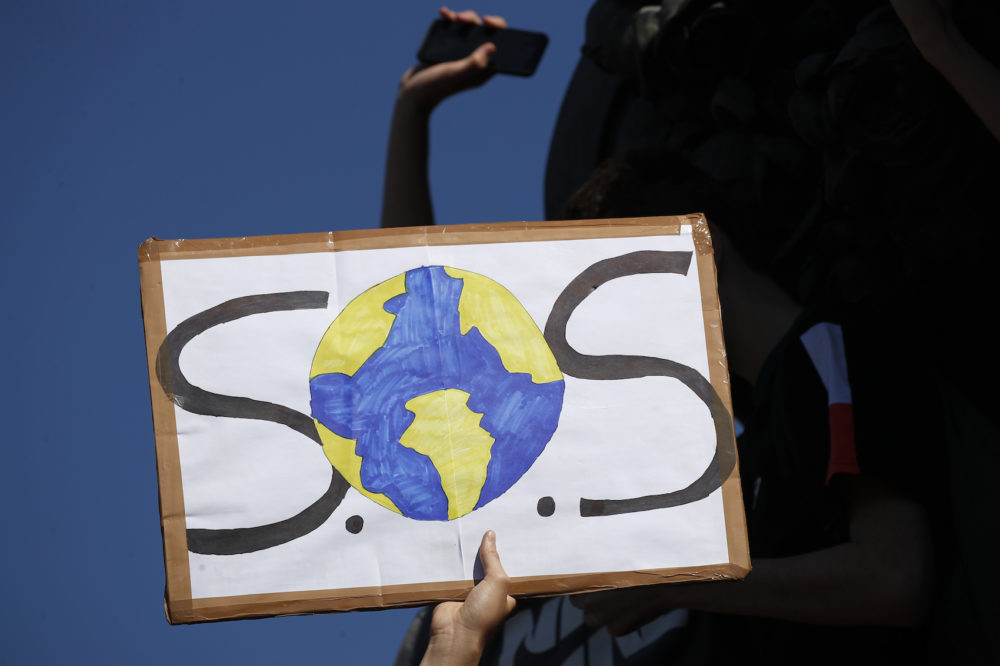 A protester shows a placard during a climate demonstration Friday, Sept. 20, 2019 in Paris. In Canberra and Kabul, Cape Town and Berlin, and across the globe, hundreds of thousands of people took the streets Friday to demand that leaders tackle climate change in the run-up to a U.N. summit. (Francois Mori/AP)