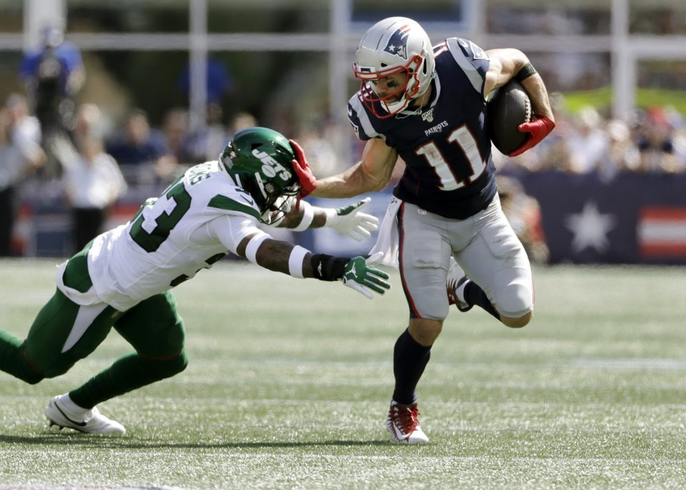 New England Patriots wide receiver Julian Edelman, right, tries to escape the grasp of New York Jets safety Jamal Adams in the first half ofteh game on Sunday. (Steven Senne/AP)