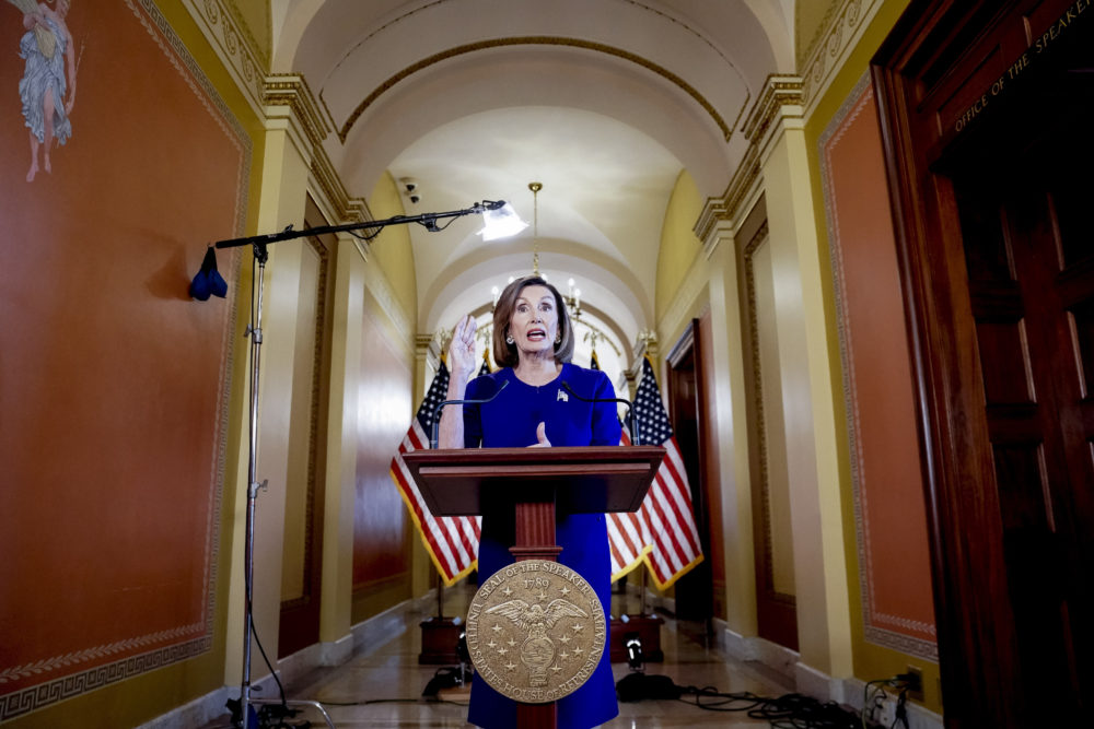 House Speaker Nancy Pelosi reads a statement announcing a formal impeachment inquiry into President Trump. (Andrew Harnik/AP)