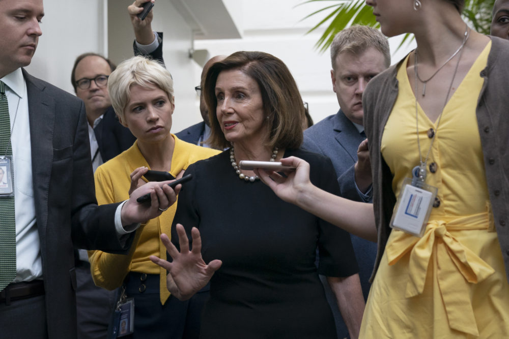 Speaker of the House Nancy Pelosi, D-Calif., is surrounded by reporters as she arrives to meet with her caucus the morning after declaring she will launch a formal impeachment inquiry against President Donald Trump, at the Capitol in Washington, Wednesday, Sept. 25, 2019. (J. Scott Applewhite/AP)
