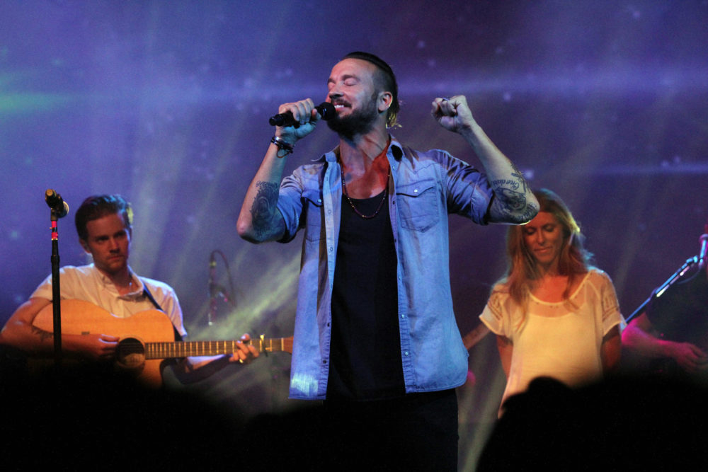 Pastor Carl Lentz, center, leads a Hillsong NYC Church service at Irving Plaza in New York.  (Tina Fineberg/AP Photo)