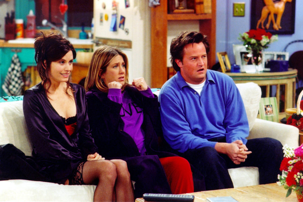 """Actors Courteney Cox (left), Jennifer Aniston (center) and Matthew Perry are shown in a scene from the NBC series """"Friends"""". (Warner Bros. Television/Getty Images)"""