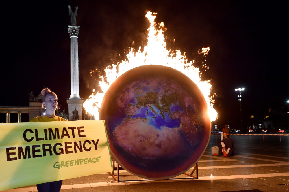 The Earth on fire is seen during a Greenpeace protest at the Heroes square in Budapest on Sept. 4, 2019. (Attila Kisbenedek/AFP/Getty Images)