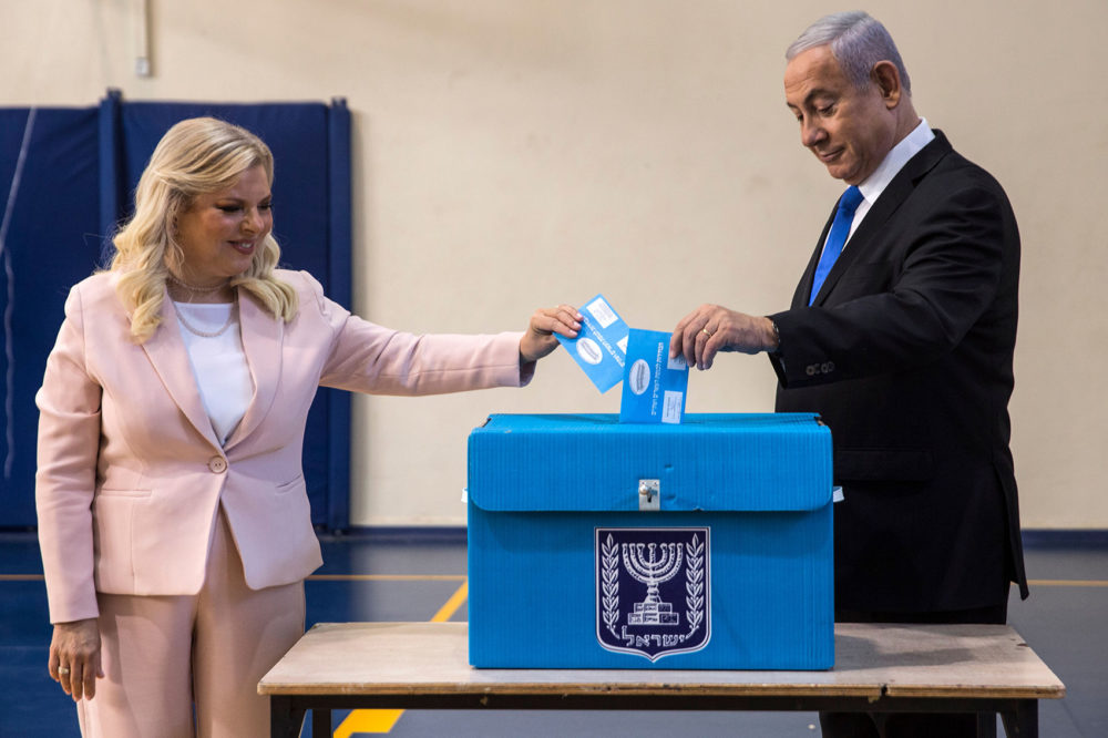 Israeli Prime Minister Benjamin Netanyahu and his wife Sara cast their votes at a voting station in Jerusalem on Sept. 17, 2019. (Heidi Levine/AFP/Getty Images)