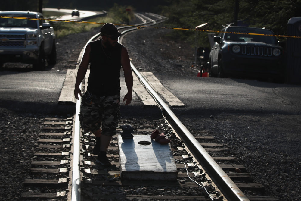 An unemployed Blackjewel coal miner, mans a blockade of the railroad tracks that lead to the mine where he once worked in Cumberland, Kentucky. (Scott Olson/Getty Images)