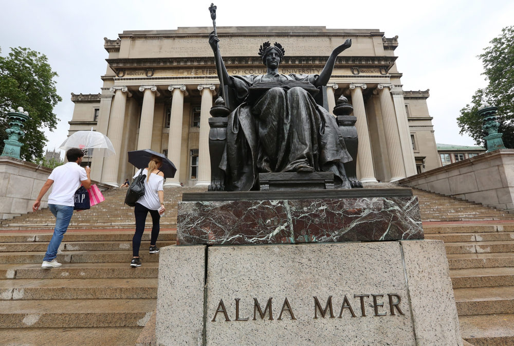 People walk past the Alma Mater statue at Columbia University. In 2018, the school was the second most expensive four-year private non-profit institution, according to the Chronicle of Higher Education. (Mario Tama/Getty Images)