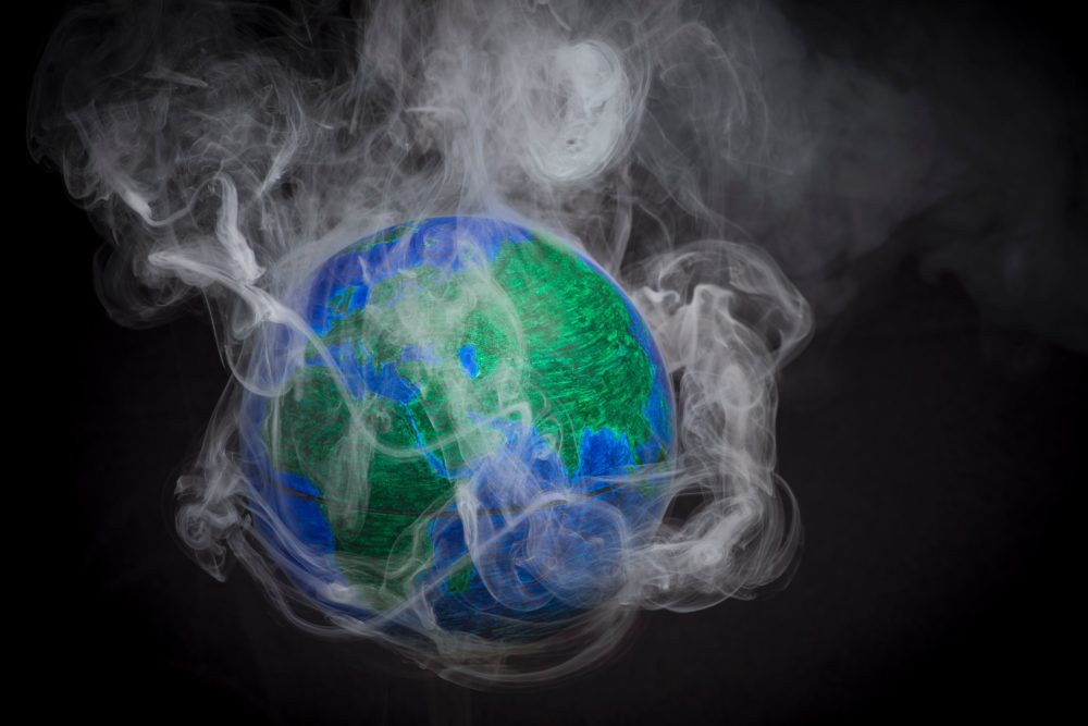 A picture taken on November 10, 2015 shows a small globe surrounded by smoke to illustrate global warming. (Lionel Bonaventure/AFP/Getty Images)