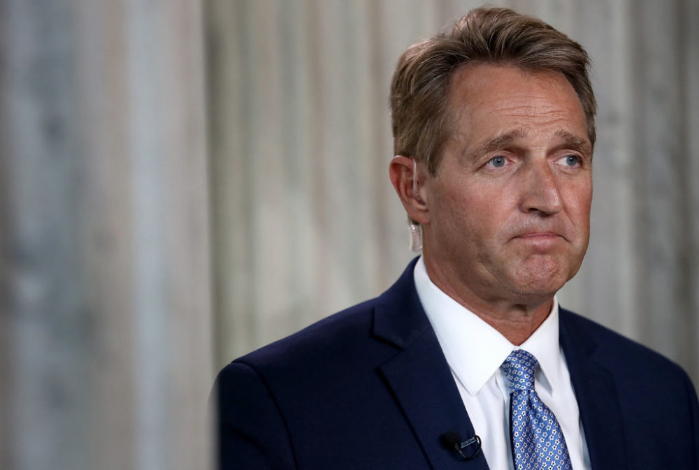 Former Sen. Jeff Flake talks to Here & Now about the impeachment inquiry into President Trump. (Win McNamee/Getty Images)