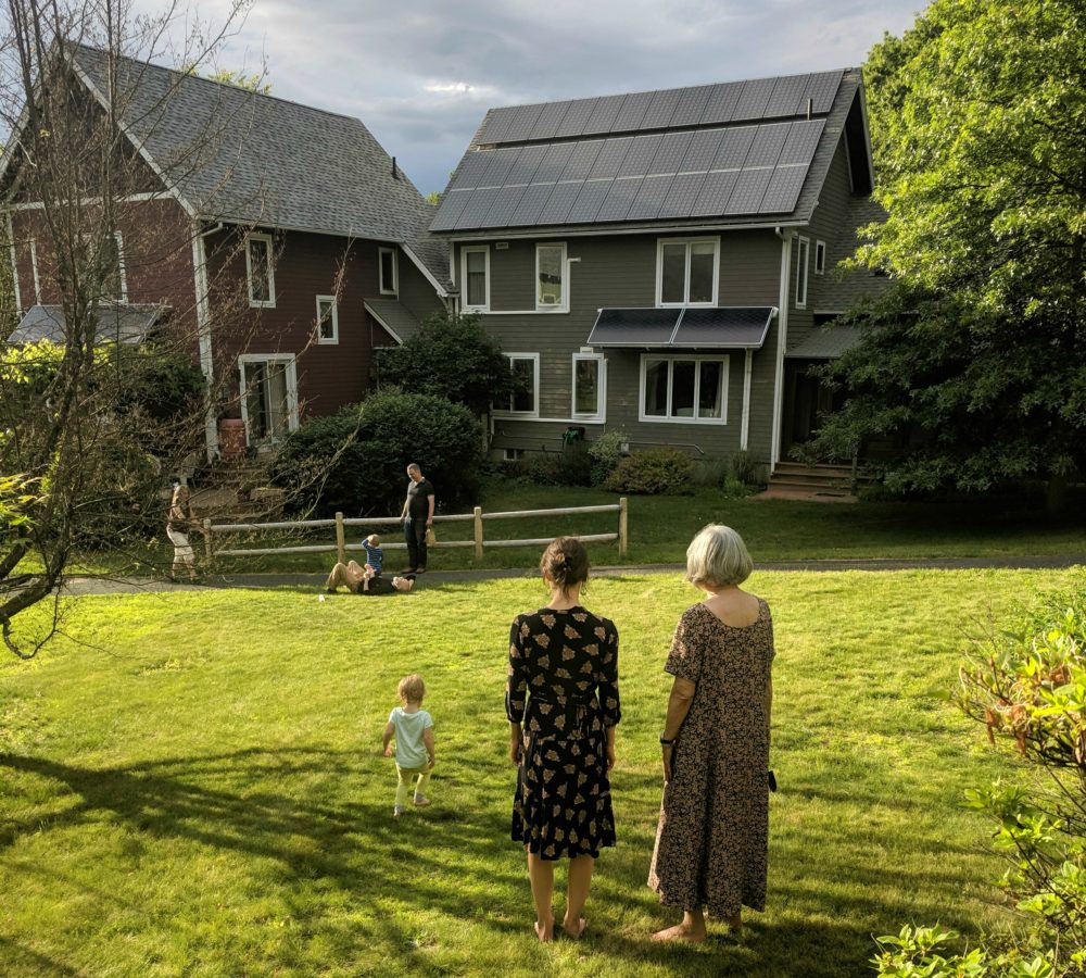 The author's daughter, wife and mother pictured in the foreground, looking at a neighbor's home in their cohousing community in central Massachusetts. (Courtesy)