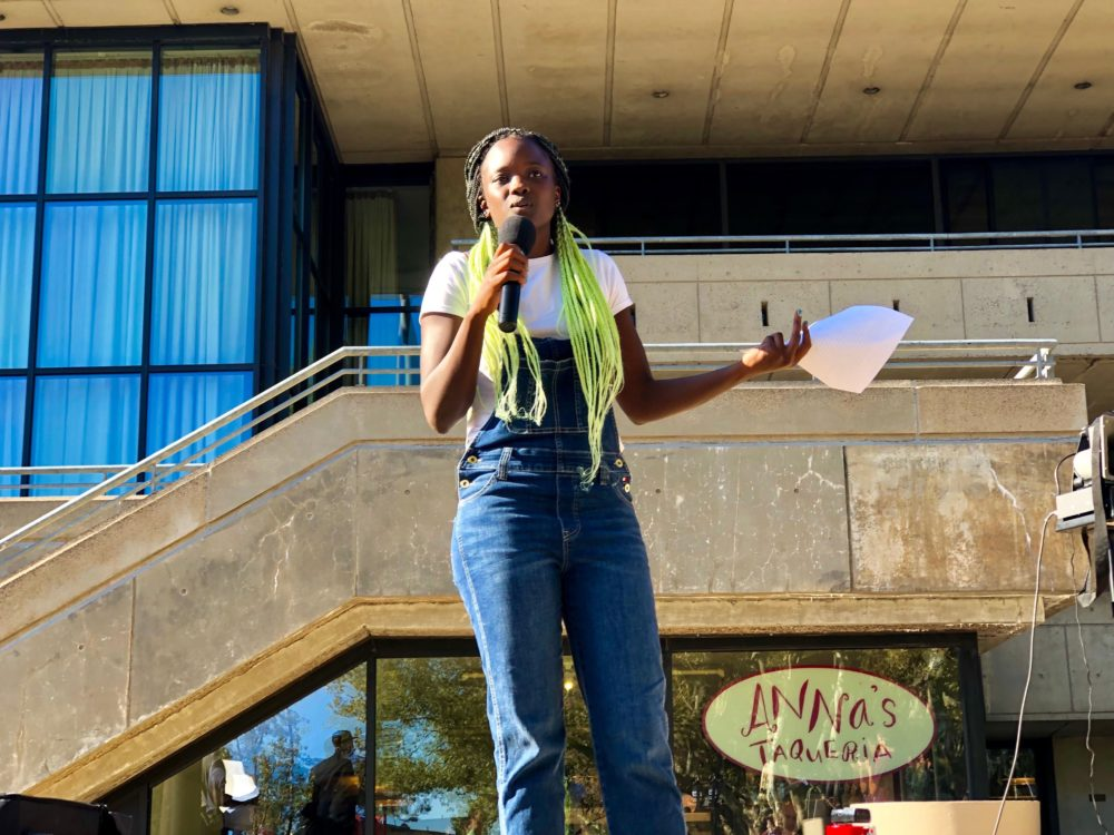 MIT Media Lab graduate student Arwa Mboya speaks at a rally outside the Stratton Student Center on Friday. (Max Larkin/WBUR)