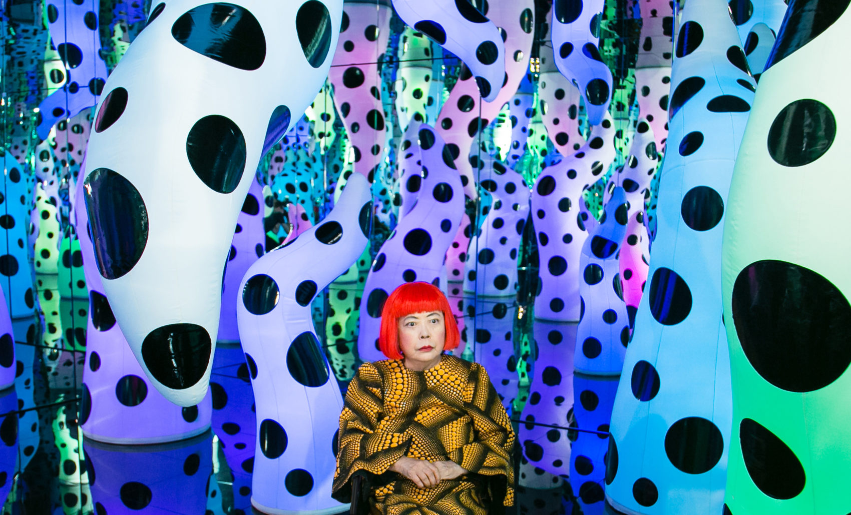 "Yayoi Kusama pictured with her work ""Love Is Calling,"" during her solo exhibition ""I Who Have Arrived In Heaven"" at David Zwirner, New York in 2013. (Courtesy David Zwirner, New York; Ota Fine Arts, Tokyo/Singapore/Shanghai; Victoria Miro, London/Venice)"