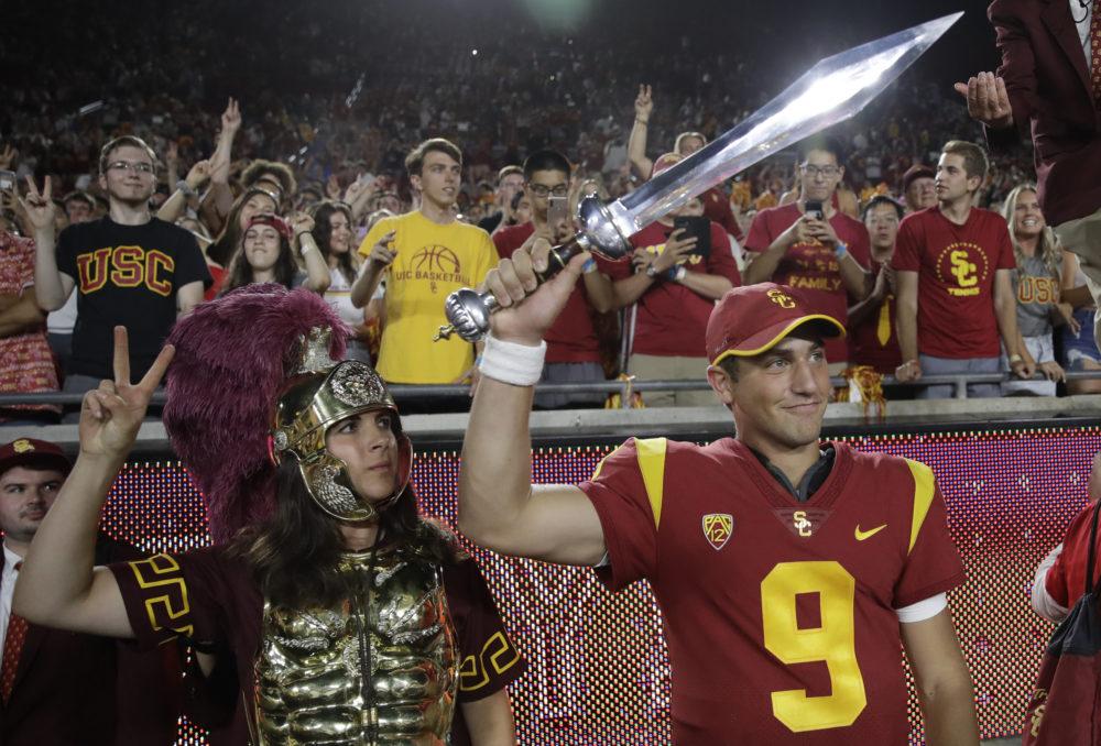 Southern California quarterback Kedon Slovis celebrates after a recent win over Stanford. (Marcio Jose Sanchez/AP)