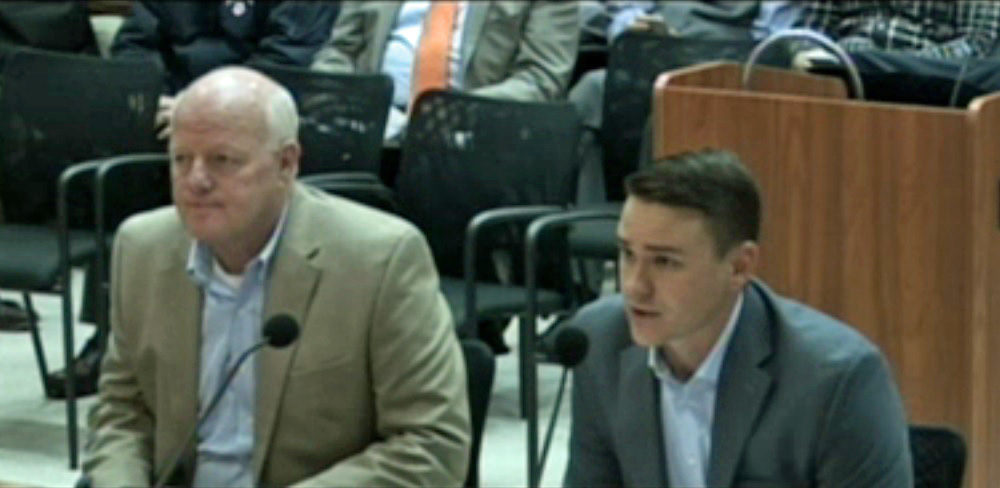 John Lynch, left, petitioned Boston's Zoning Board of Appeal in 2016 to allow him to build a duplex on a lot where two-family homes are normally prohibited. He was joined by architect James Christopher, whose father ran the city's Inspectional Services Department at the time. (Video still)
