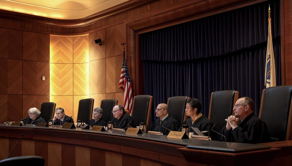 The justices of the Massachusetts Supreme Judicial Court hear a case in May 2019. (Robin Lubbock/WBUR)