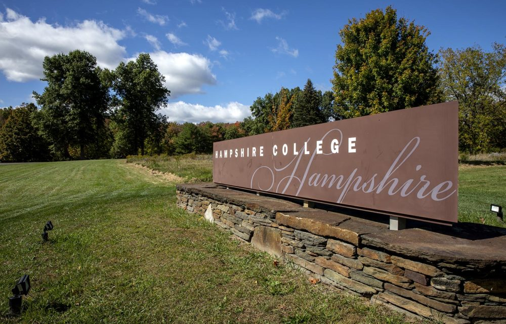 The Hampshire College sign at the entrance to the campus. (Robin Lubbock/WBUR)