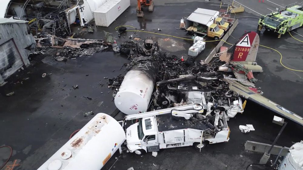 This image taken from a National Transportation Safety Board video shows damage from a World War II-era B-17 bomber plane that crashed Oct. 2 in Windsor Locks, Conn. (Courtesy NTSB)