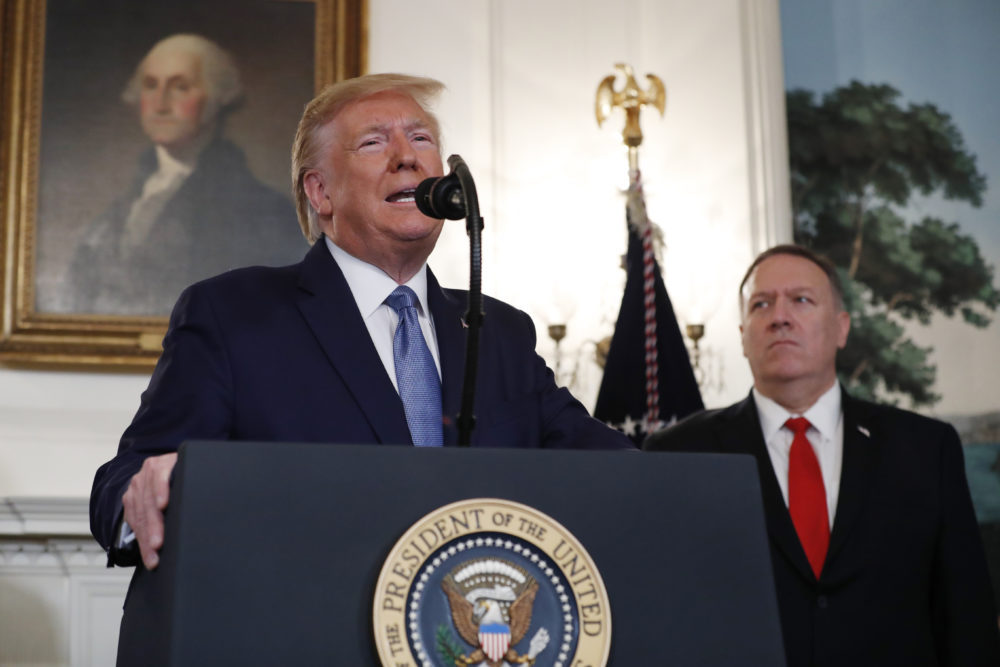 President Trump, accompanied by Secretary of State Mike Pompeo, speaks in the Diplomatic Room of the White House in Washington. (Jacquelyn Martin/AP)