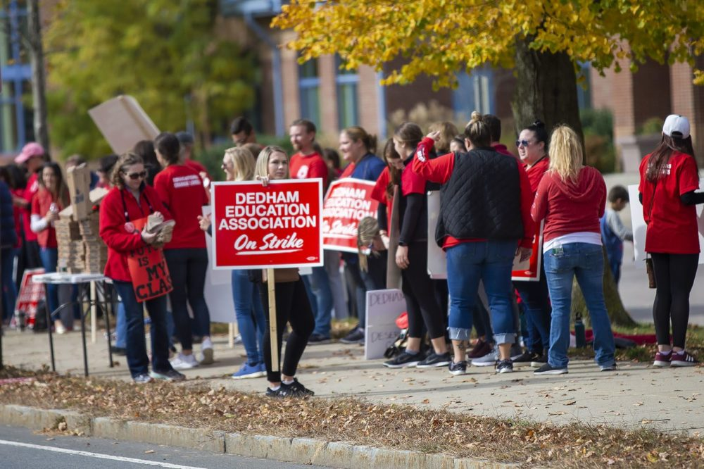 Dedham teachers striking out in front of the Dedham Middle School. (Jesse Costa/WBUR)