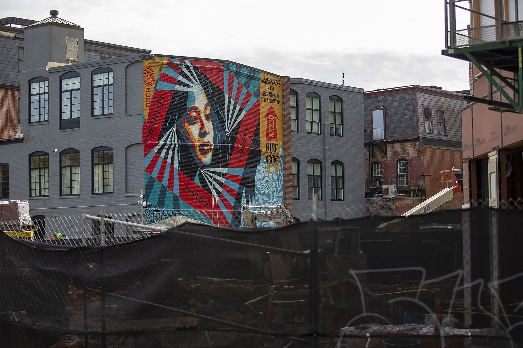 Shepard Fairey's mural on the Founder's League building on Clemence Street in Providence. (Jesse Costa/WBUR)