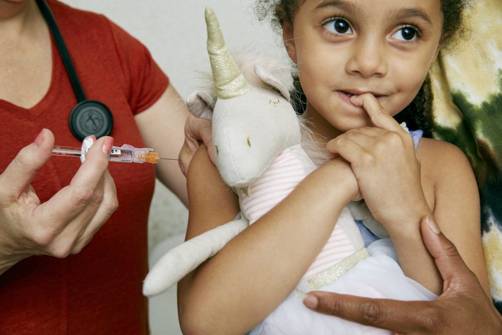 A young girl gets a flu vaccine. (Self X American Academy of Pediatrics Vaccine Photo Project/Flickr)
