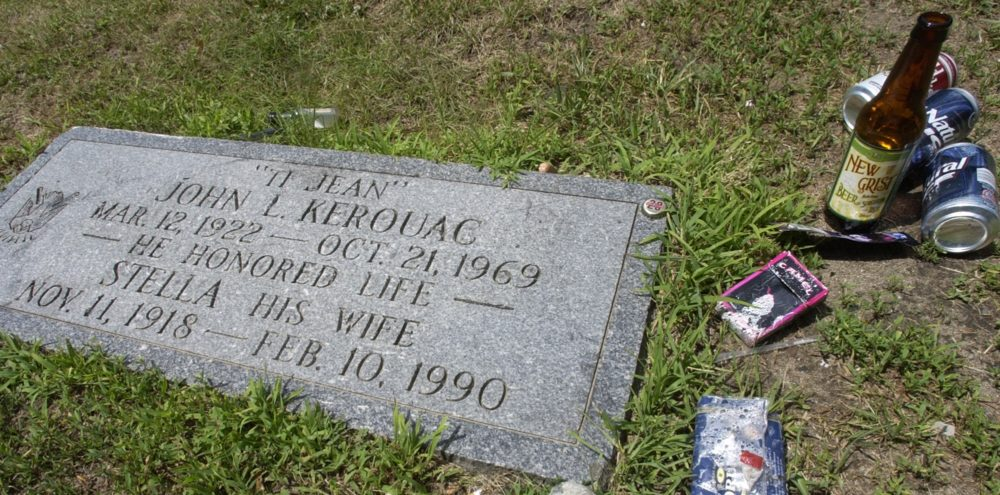A beer bottle, cans and other items were left beside the grave of author Jack Kerouac, July 7, 2007 at the Edson Cemetery in Lowell, Mass. (Lisa Poole/AP)