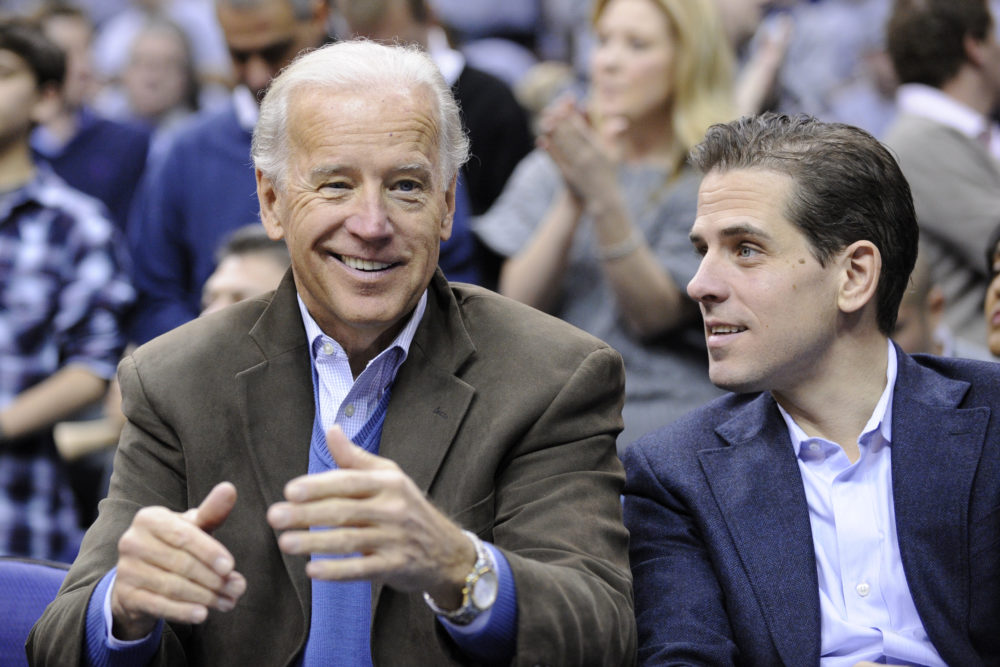 Former Vice President Joe Biden with his son Hunter at the Duke Georgetown NCAA college basketball game in 2010. (Nick Wass/AP)