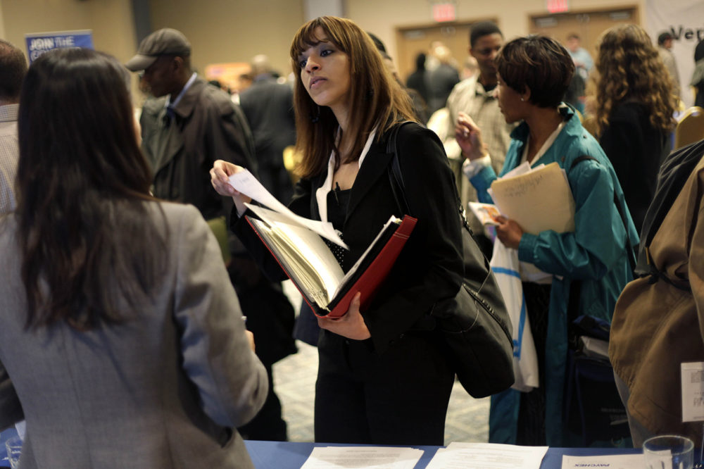 A woman at a job fair in New York talks to an employer. (Seth Wenig, File/AP)
