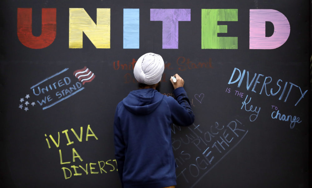 In this December 6, 2016 photo, Texas A&M student Harsimran Singh, from India, signs a message board at an event in College Station, Texas. (David J. Phillip/AP)