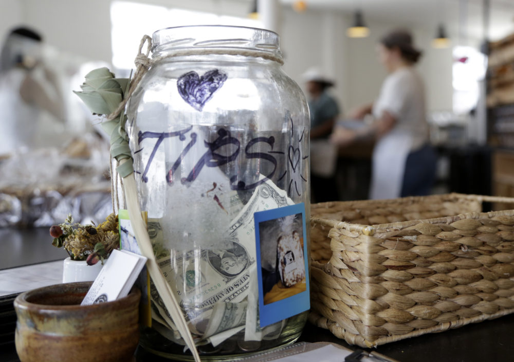 A tip jar sits on the counter at Zak the Baker in Miami. (Lynne Sladky/AP)