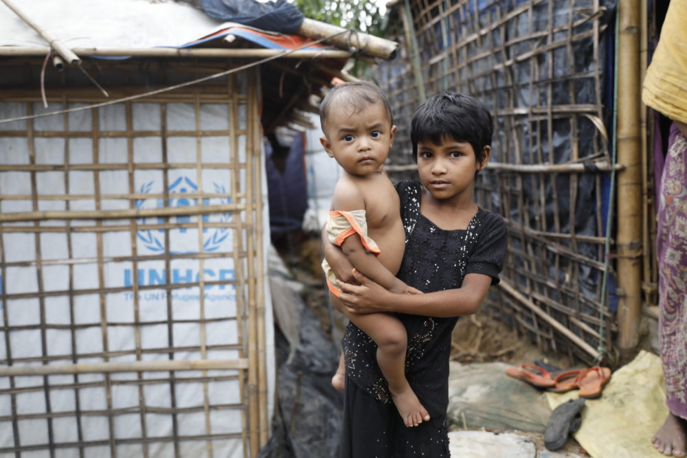 A Rohingya refugee girl holds a child  at the Kutupalong refugee camp in Cox's Bazar district, Bangladesh, Monday, June 2, 2018. (AP)