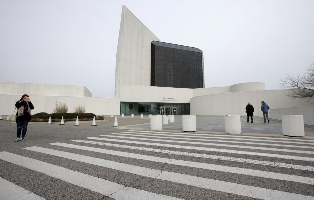 Passers-by walk near an entrance to the John F. Kennedy Presidential Library and Museum in Boston (AP Photo/Steven Senne)
